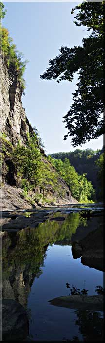 Panorama of a reflection of a cliff at Taughannock Falls.